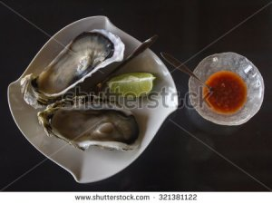stock-photo-fresh-oysters-and-condiments-321381122